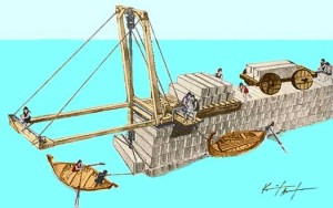 Construction of a mole in the harbour of the city of Amathus in Cyprus with a crane rolled along the mole. Workers on boats adjust the blocks.